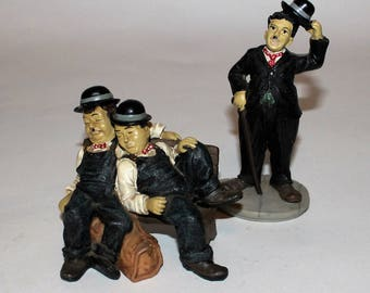 2 statuettes Old comedians