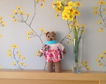 Knitted teddy in pink outfit