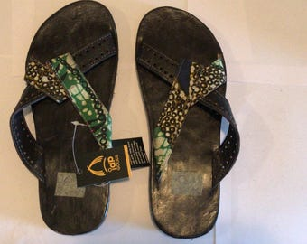 Leather slippers with African fabric