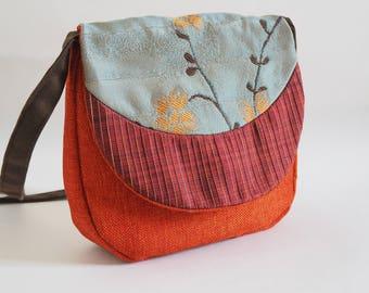 Orange and blue fabric flap shoulder bag
