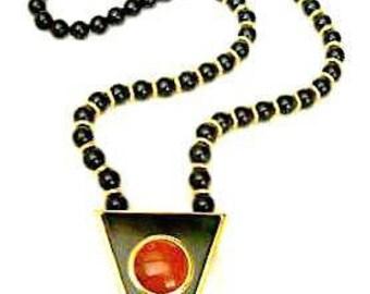Alexis Kirk. Long Lucite Bead Pendant Necklace Carnelian Glass