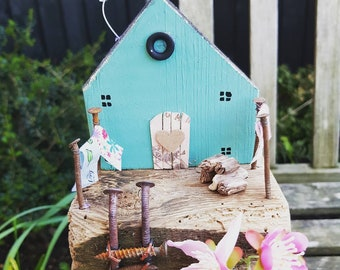 Little Wooden House in Green made from reclaimed materials and driftwood