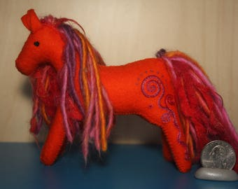 Wool felt art horse- orange with hand embrodered spirals and a multicolor mane.