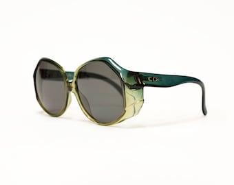 80s Round oversize vintage sunglasses by Christian Dior, rare green designer eyewear in unworn new old stock condition.