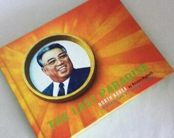 The Last Paradise, North Korea, Nicolas Richetti,Hardcover book, kitschy, interesting book, satire on No. Korea, 1st edition, illustrated