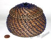 Dancing Rain a beaded pine needle basket with a beaded flower embellishment on the lid, gift, pine needle basket.