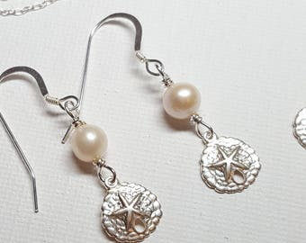 Tiny Pearl and sand dollar earrings. Freshwater pearls and sterling silver