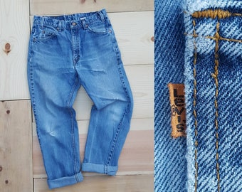 """Vintage Levi's 505 Jeans  //  Vtg 90s Levis Made in the USA Distressed Faded Stone Wash Indigo Denim Jeans w/ Holes  //  31.5"""" waist"""