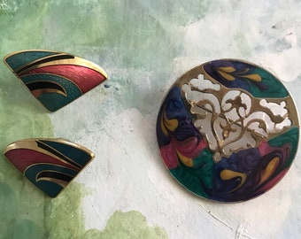 Enameled brooch andcomplimentary earrings.