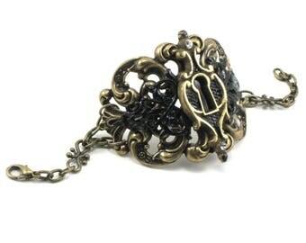 Steampunk Cuff Bracelet w/ Hand Painted Escutcheon Keyhole in Black and Brass - Alice in Wonderland Inspired, Gothic Lolita, Bohemian, Boho