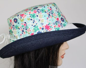 Sunblocker UV summer hat sun hat with large wide brim featuring small floral on white background and adjustable fit