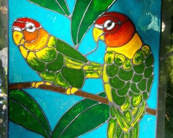 Two lovebirds in a tree jungle window cling
