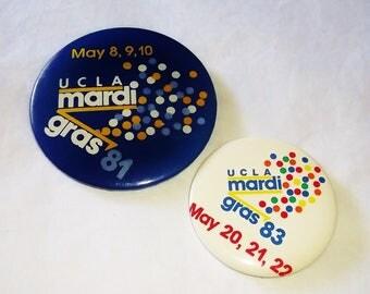 2 vintage 80s U.C.L.A. MARDI GRAS PINBACKS • 1983 & 1981