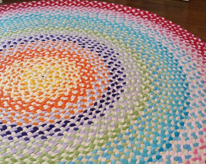 "58"" braided rug created from recycled t shirts and some new t shirt fabric"