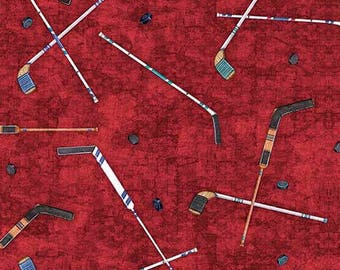 Face Off from Quilting Treasures - Full or Half Yard of Hockey Sticks on Red Background