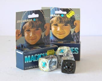 Two Packages of Three Sylvania Magic Cubes