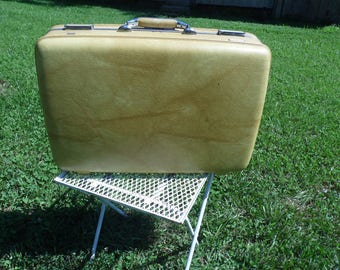 American Tourister vintage medium suitcase gold marbled suitcase with yellow interior for travel, display, storage, photo or play props