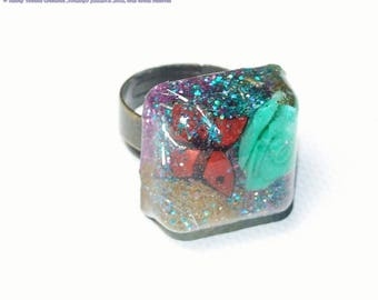 Square resin ring with pink inclusion and butterfly, spangled