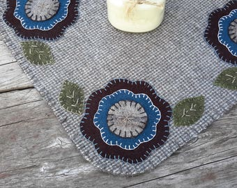 Wool penny rug, wool candlemat