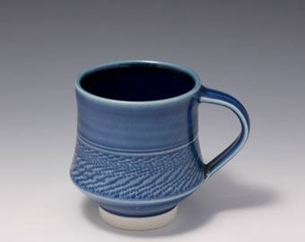 Wheel-thrown Porcelain Mug with Blue Glaze and Chattering texture  by Hsinchuen Lin 林新春