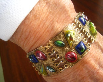 """Vintage Panel Bracelet with Blue Square, Deep Red Oval, Dark Green Oval, Gold/Green Triangle Art Glass Cabs. Etruscan Styling. 1"""" Wide."""