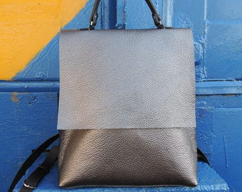 Backpack from a genuine leather of color of dark silver