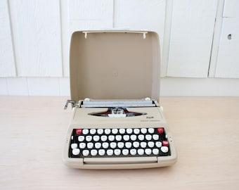 Vintage tan and white Smith Corona Corsair portable manual typewriter