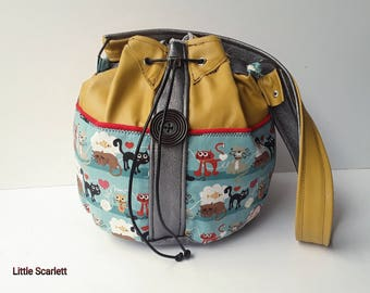 Yellow and silver leather bucket bag and tissue cats