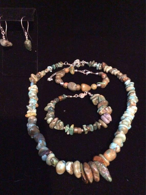 Turquoise jewelry set, including necklace, bracelets, and dangle earrings with handmade sterling silver ear wires.