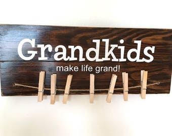 Grandkids make life grand sign with clothespins. Handmade and painted. Grandparent wood sign