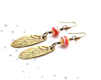 White Murano glass gold wing rbonze leaf earrings