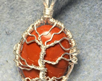 Tree of Life on Red Jasper Gemstone.  Helps with conflict & aggression. Promotes grace, perserverence.  Tarnish resistant silver craft wire
