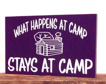What happens at camp stays at camp wooden sign