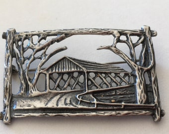 A Covered Bridge Brooch in a Well Articulated Vine Covered Frame Sterling Silver by Michele