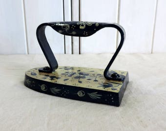 A hand painted, vintage French, sad iron in blue and white
