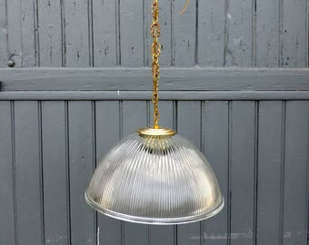A Vintage french, clear glass holophane ceiling or pendant light from the 1930s, industrial chic