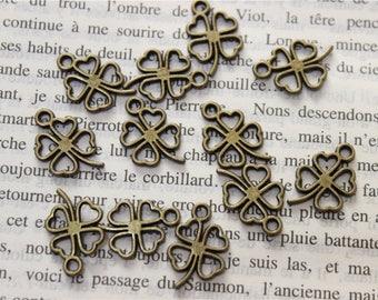 50 hollowed four leaf clover pendant charms antique bronze