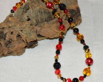 Decadent, rich red black and amber beaded necklace