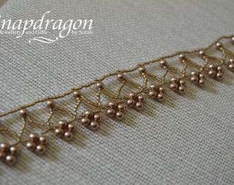 Beaded choker with Swarovski glass pearls in Crystal Bronze.