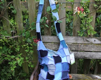 Stylish upcycled patchwork cross body wool bag. Shades of blue with purple thread. Recycled wool knitwear. OOAK Fully lined. Handmade in UK
