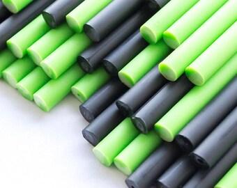 x50 Ghouilish Green Plastic Lollipop Sticks 114mm x 4mm Green & Black Halloween
