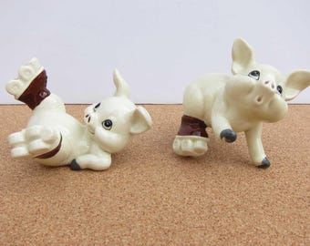 Vintage Quon-Quon Japan Roller Skating Pigs Figurine  - Set of 2 1950s Ceramic Playful Piggy Collectibles