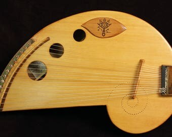 Lap Harp. The seedling by Rays Rootworks. 15 string zither pins. Nylon or steel string.