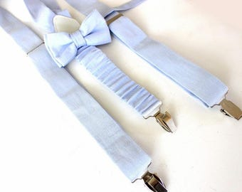 Suspenders with bow, light blue, pastel