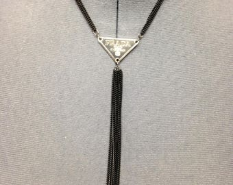 Authentic metal tag Prada repurposed into the black chain . Handmade !
