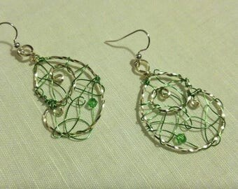 Silver spiral hoops with green swirls