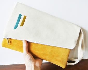 Canvas and yellow suede foldover clutch with hand embroidered detail