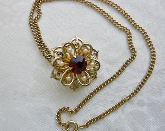 Lovely Goldtone Flower Brooch Pendant Ruby Red Rhinestone Center Surrounded by Seed Pearls Designer Gift