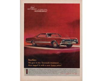 Vintage poster advertisement of a 1966 Oldsmobile  Starfire