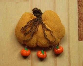 Fabric pumpkin brooch + polymer clay